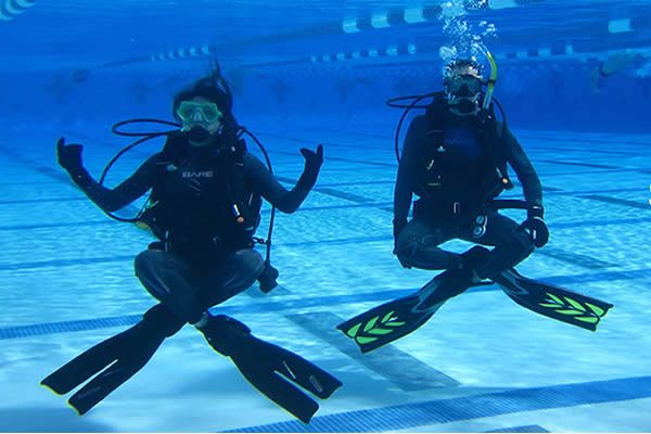 diver candidates practicing buoyancy through hovering