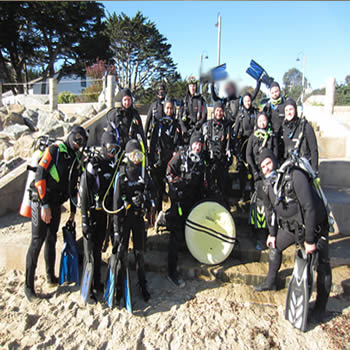 we survived! Class of 2-18 graduates at the breakwater in monterey